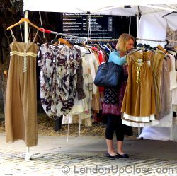 Searching through rails of new and vintage frocks at the Cabbages and Frocks Market in Marylebone