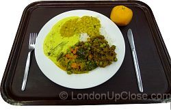 This dinner at the Indian YMCA in London is a great mix of white rice, lentil dhal, two vegetable curries and minced lamb curry, plus an orange for dessert. You can go back for seconds if you're still hungry...