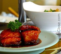 Fried sweet glazed salmon, and a dish of tofu at Kulu Kulu Sushi