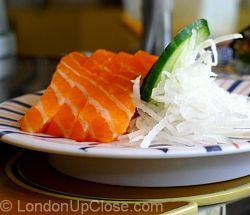 Salmon sashimi, with grated white radish and cucumber, at Kulu Kulu Sushi