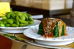 Spinach roll and sesame sauce, and boiled edamame soya beans in their shells at Kulu Kulu Sushi
