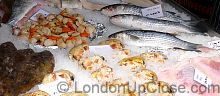 Grey Mullet, sea bass, scallops and dressed crab on the fish stall on Marylebone Farmers' Market