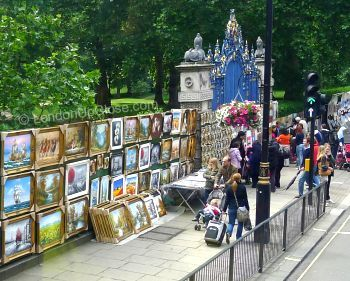 Paintings galore along the perimeter of Green Park on Piccadilly along the route of the Routemaster heritage bus route 9