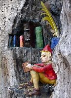 An elf enjoys his library in the Elfin Tree, outside the Princess Diana Memorial Playground.