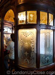 The cosy mahogany and etched glass booths in the Princess Louise Pub in Holborn comfortably seat about eight people.