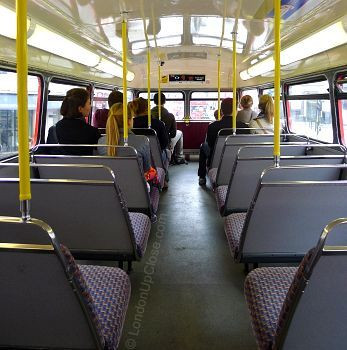 The upper deck on a Routemaster bus - a bit bumpy and shaky and rather cramped... but fun!