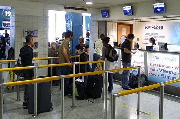 The Eurolines continental check-in counter, adjacent to Gate 19.